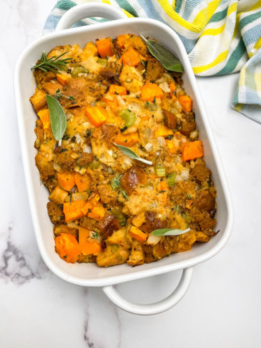 vegan butternut squash stuffing in a white casserole pan on a white background