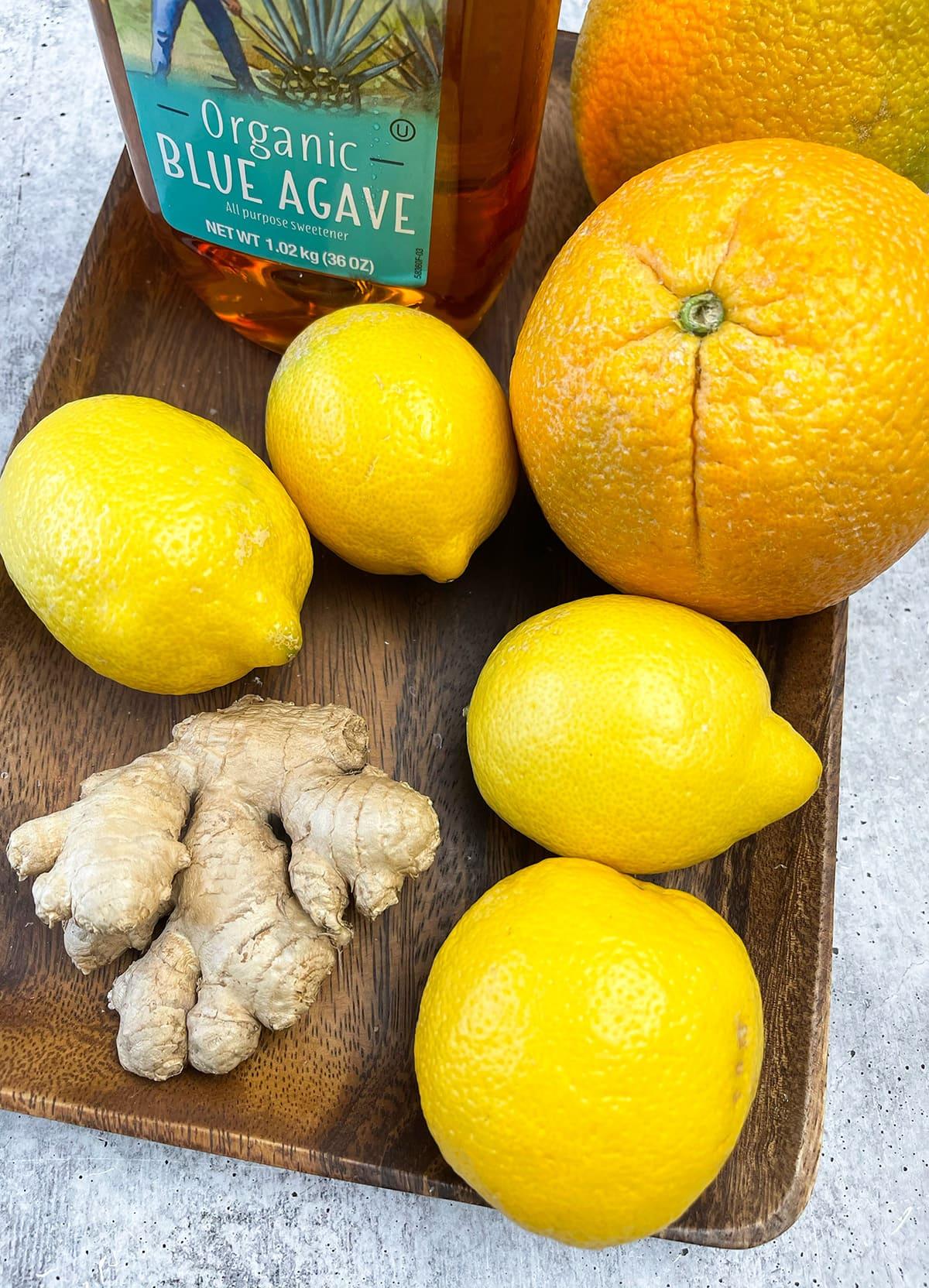 Orange lemonade ingredients, lemons, oranges, ginger, agave, water