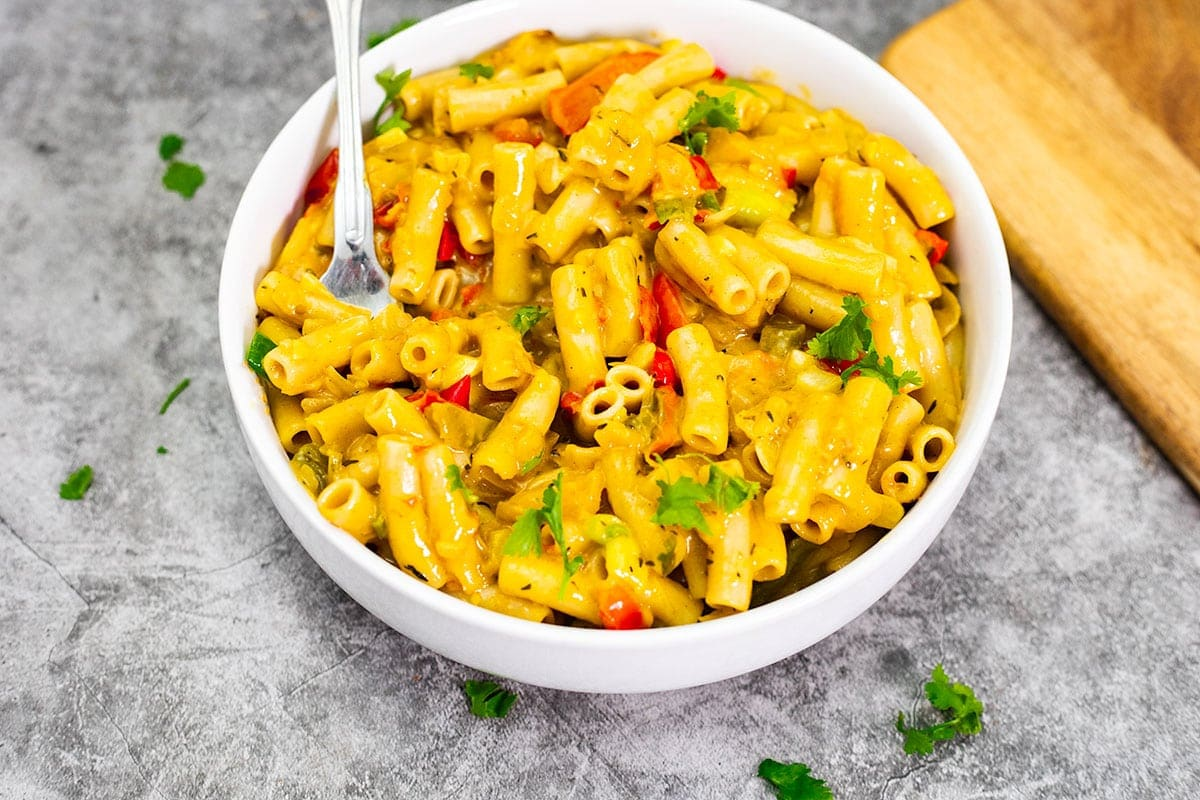 a white bowlful of rasta pasta with a fork
