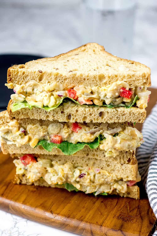 three diagonal halves of chickpea salad sandwiches