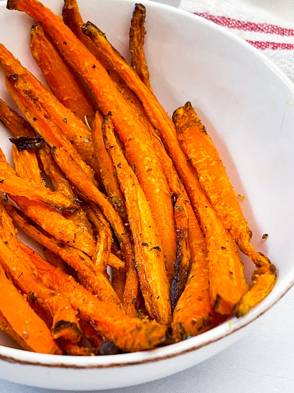 carrot fries close up in a white bowl