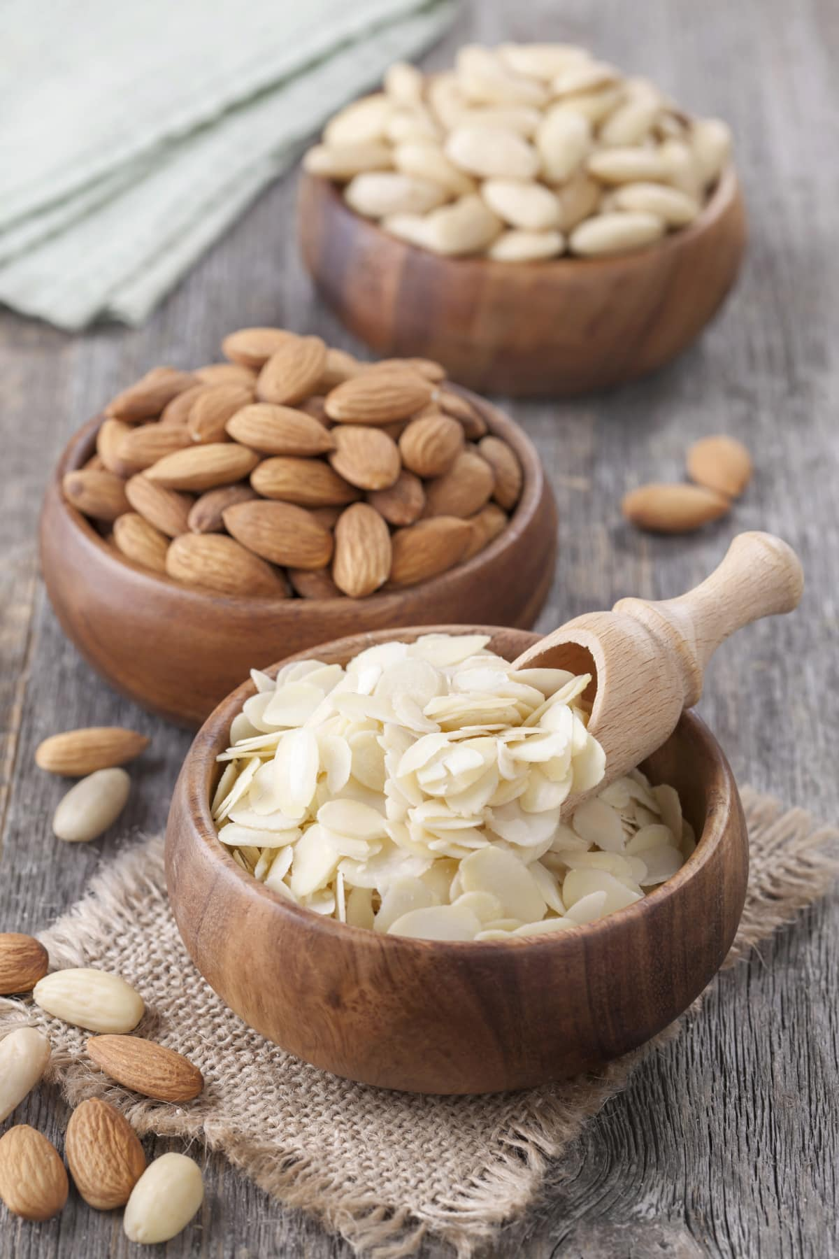 wooden bowls of slivered, whole, and blanched almonds