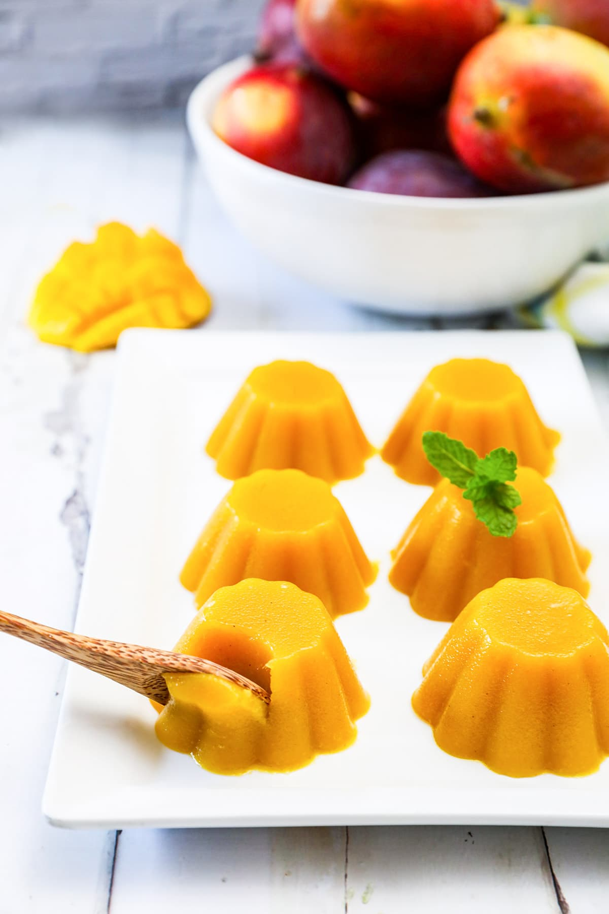 mango pudding on a white platter on wooden background