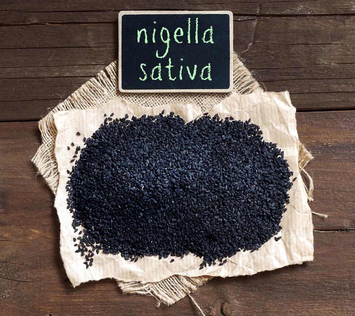 Nigella Sativa on a wooden background