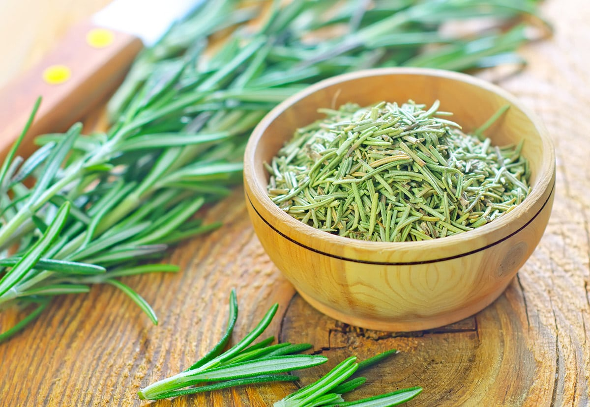 rosemary fresh and dried on a wooden background