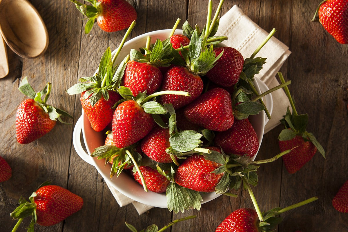 overlay of strawberries in a bowl
