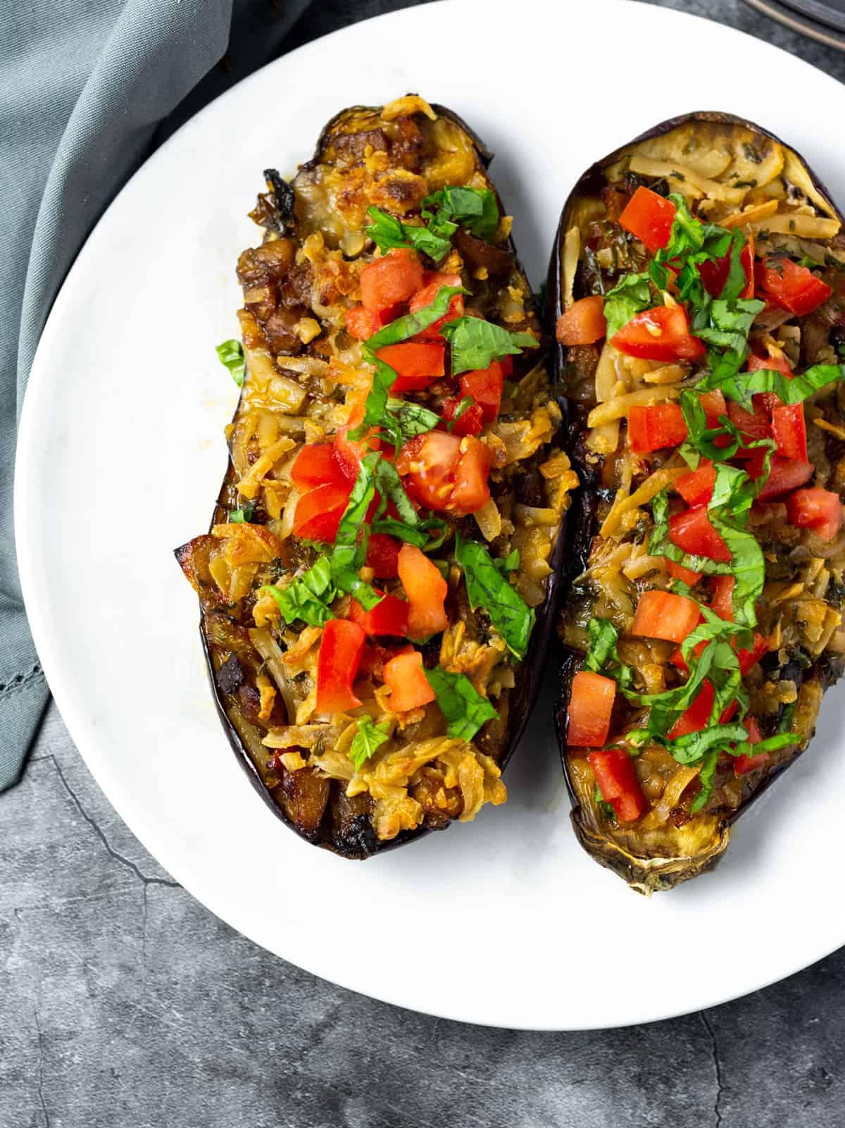 vegan stuffed eggplant on a white plate