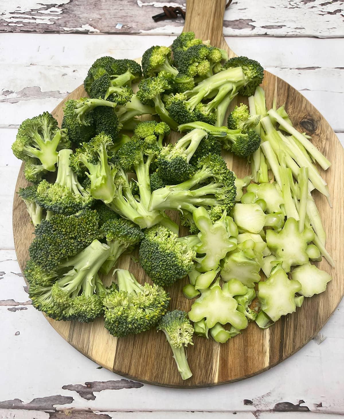 broccoli cut 3 different ways on a cutting board