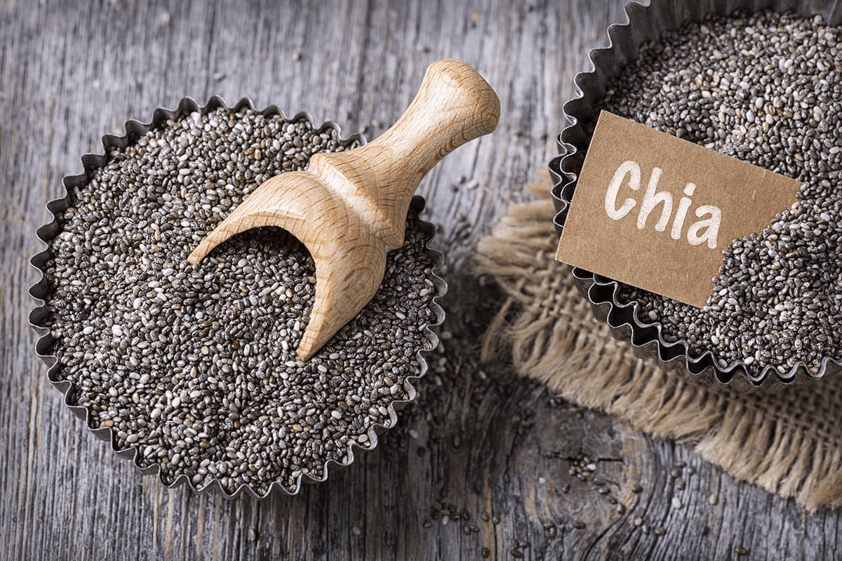 chia seeds in a tin on a wooden background