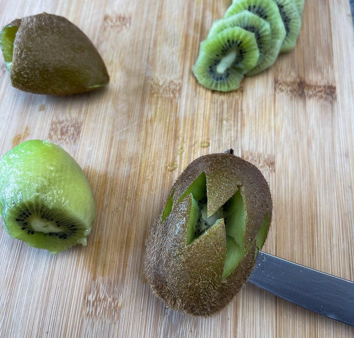 cutting kiwi with a knife