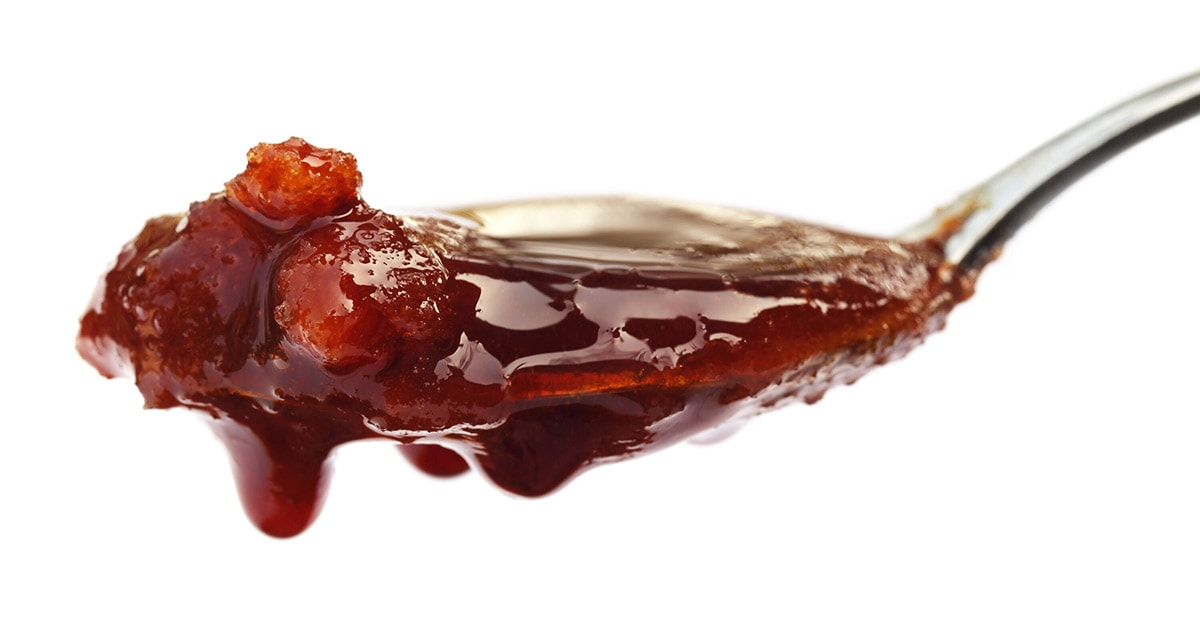 date syrup on white background
