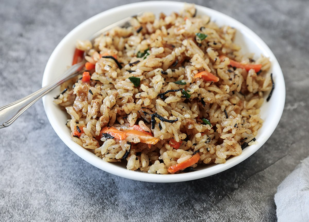 copycat Japanese fried rice in white bowl on a grey background