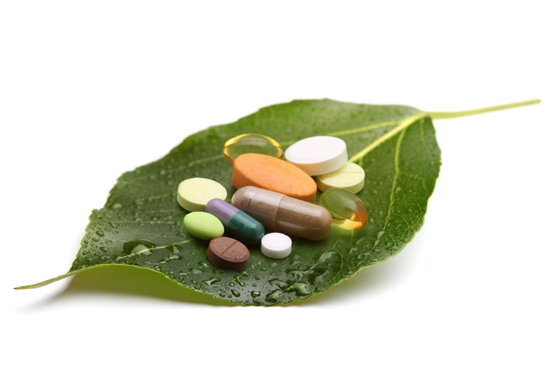 Vitamins on a leaf on a white background